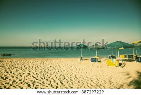 sunbeds on empty beach  ...