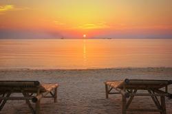 Sunbeds on the beach at sunset