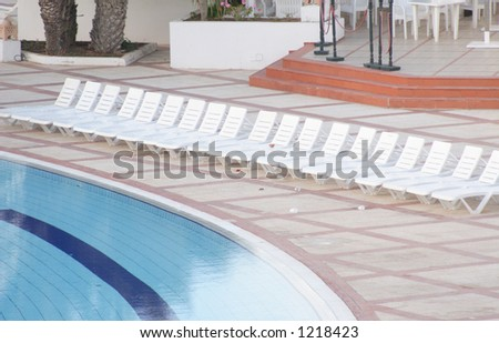 sunbeds standing at the swimming pool