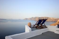 sunbeds with Seascape of Santorini