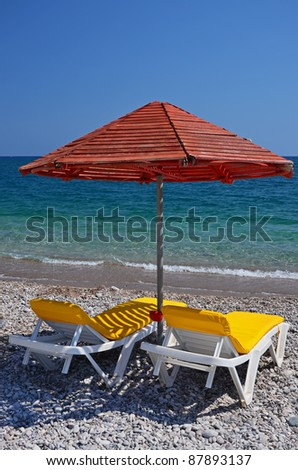 Sunbeds with umbrella on Kolymbia beach, Rhodes island