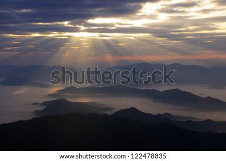 Sunburst through clouds at phucheefah