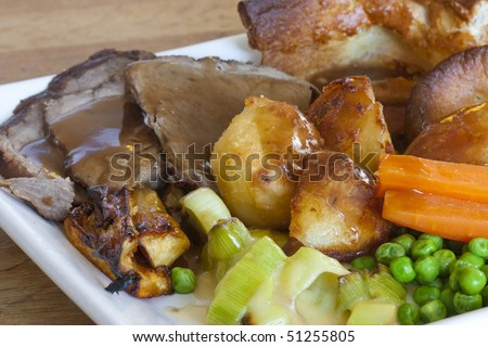 sunday roast dinner on an old wooden table