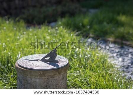 Sundial in the Summer sun #1057484330
