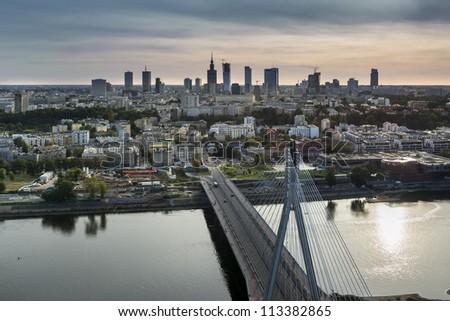 Sundown over Warszawa city, Poland with Vistula river