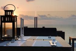 Sundown, sunset sea view rooftop bar and restaurant dining.