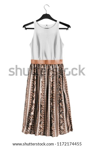 aba841eb9c0 Sundress with brown flared skirt hanging on black clothes rack isolated  over white  1172174455