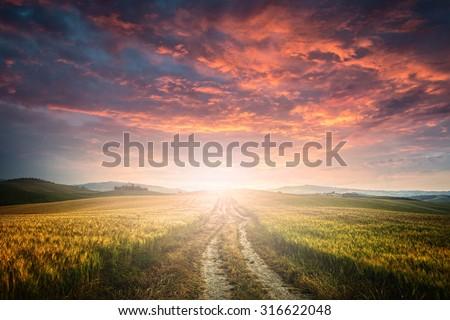 sunet over dirt road