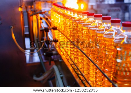 Sunflower oil. Factory line of production and filling of refined oil from sunflower seeds. Factory conveyor of food industry. stock photo