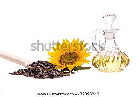 Sunflower oil, with sunflower and seed on a white background