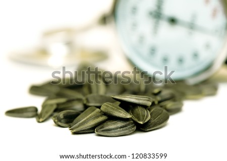 Sunflower seeds with stethoscope in background