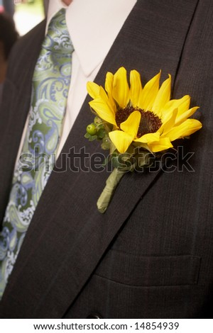 stock photo Sunflower Wedding Boutonniere On Suit Jacket of Groom