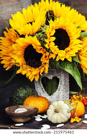 Sunflowers and Autumn decorations on wooden background #215975461