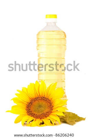 Sunflowers and  bottle with sunflower oil isolated on white background