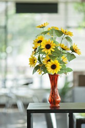Sunflowers in a vase of red