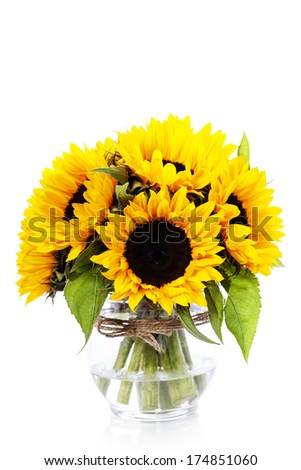 Sunflowers in a  vase over white #174851060