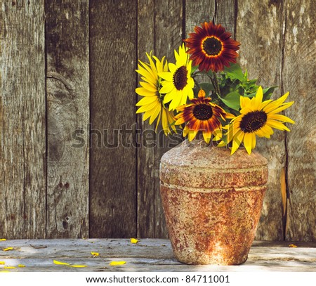 Sunflowers on a grunge wood background with copy space.