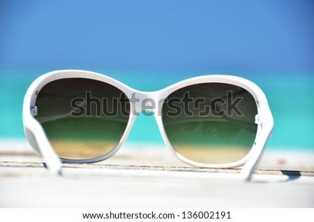 Sunglasses against tropical ocean