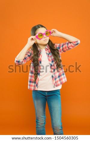 Sunglasses fancy accessory. Improve eyesight. Girl kid wear eyeglasses. Optics and eyesight treatment. Effective exercise eyes zooming. Child happy with good eyesight. Eyesight and eye health.