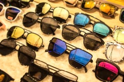 Sunglasses in many dark UV shades for different styles.  Shopping for discounts and sales at eyeglass market shop.  Get your discounted and cheap variety colored shades here.