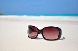 sunglasses in the sand at the beach. Similan Islands, Thailand