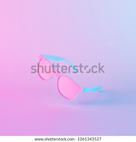 Sunglasses in vibrant bold gradient purple and blue holographic colors. Concept art. Minimal summer surrealism.