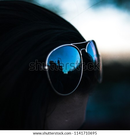 Sunglasses on a brunette haired person #1141710695