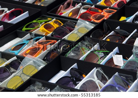 Sunglasses on a market stall - stock photo