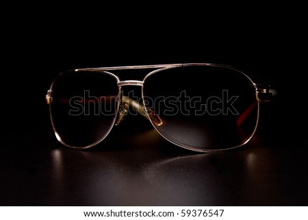 Sunglasses on black background