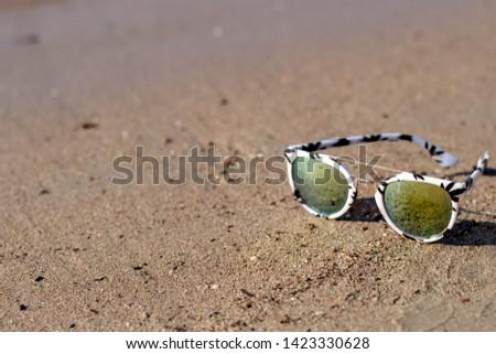 Sunglasses on the beach, Single Object #1423330628