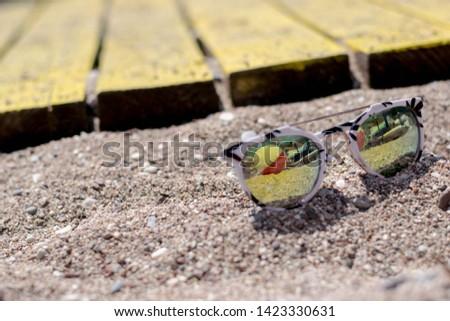 Sunglasses on the beach, Single Object #1423330631