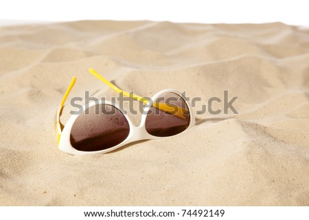 sunglasses on the beach ,white background focus on center sunglasses