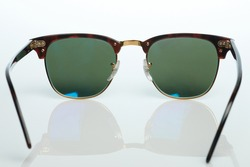 Sunglasses shade isolated back view with green glass