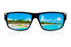 Sunglasses  with a tropical beach and sailing boats reflected where the lenses should have been isolated on white
