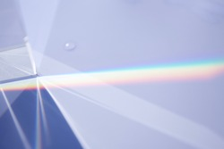 Sunlight and prism on the white bord
