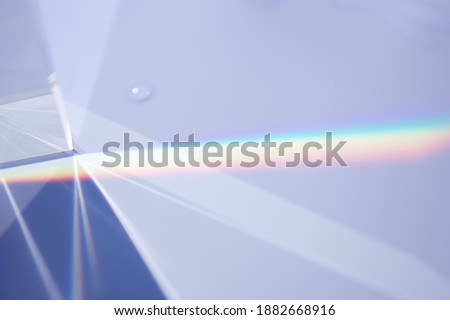 Sunlight and prism on the white bord Foto stock ©