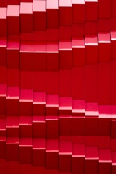 Sunlight and shadow on abstract and geometric zigzag pattern of modern red aluminium composite wall in vertical frame