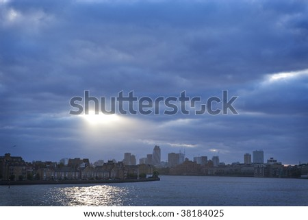 Sunlight coming through clouds over London