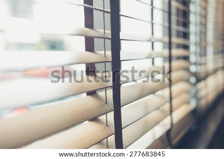 Sunlight coming through venetian blinds by the window #277683845