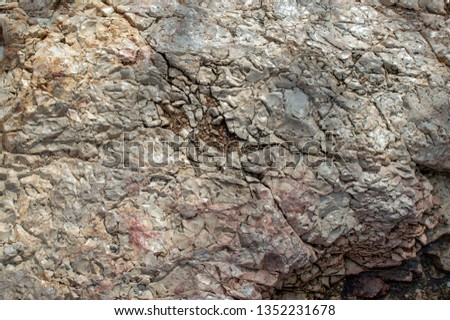 Sunlight glistens off the surface of crakced rocks making a neat background or texture.