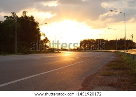 Sunlight in the evening with evening sky. The sun shines on the road. #1451920172