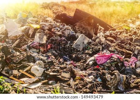 sunlight large pile of debris, city dump, pollution