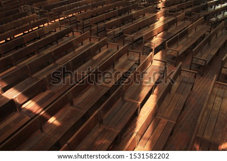 Sunlight projected on the church's benches.