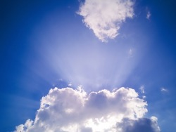 Sunlight Rays Over The Cloud. Different Cloudscape In Bangladesh. Sunrays Shinning By The Autumn Blue Sky.