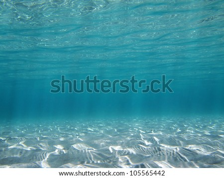 Sunlight reflecting on a shallow sandy seabed in the Caribbean sea - stock photo