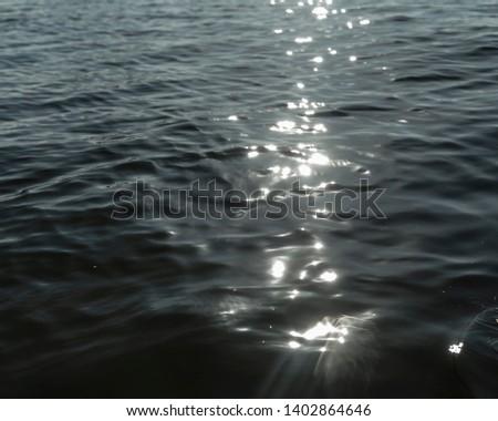 Sunlight reflection glistening on Water