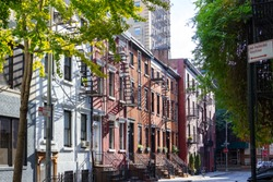 Sunlight shines on the historic buildings along Gay Street in the Greenwich Village neighborhood of Manhattan in New York City