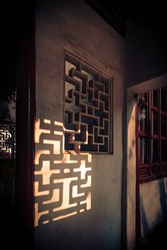 Sunlight shines on the wall, abstract Chinese style windows.