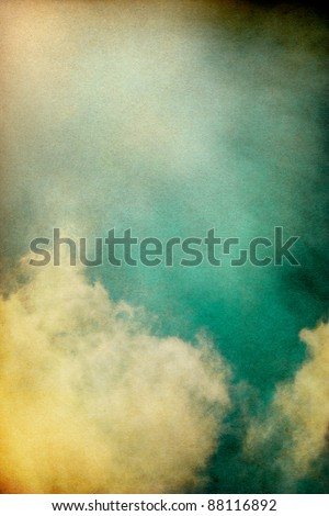 Sunlight shining through textured vintage clouds.  Image has a pleasing paper grain and texture at 100%.