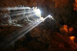 Sunlight through a cave hole.